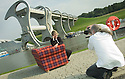 05/08/2004   Copyright Pic: James Stewart.File Name : jspa02_yerbury.PHOTOGRAPHER TREVOR YERBURY EMBARKS ON HIS SCOTLAND'S PEOPLE EXHIBITION AT THE FALKIRK WHEEL WITH HIS TARTAN SOFA AND THE HELP OF THE CANDIDATES FOR THE SNP LEADERSHIP, MIKE RUSSELL, ROSESANA CUNNINGHAM AND ALEX SALMOND......Payments to :.James Stewart Photo Agency 19 Carronlea Drive, Falkirk. FK2 8DN      Vat Reg No. 607 6932 25.Office     : +44 (0)1324 570906     .Mobile  : +44 (0)7721 416997.Fax         :  +44 (0)1324 570906.E-mail  :  jim@jspa.co.uk.If you require further information then contact Jim Stewart on any of the numbers above.........
