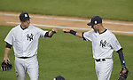 (L-R) Hiroki Kuroda, Derek Jeter (Yankees),<br /> SEPTEMBER 25, 2014 - MLB :<br /> Hiroki Kuroda of the New York Yankees bumps fists with teammate Derek Jeter after the bottom of the eighth inning during the Major League Baseball game against the Baltimore Orioles at Yankee Stadium in the Bronx, New York, United States. (Photo by AFLO)