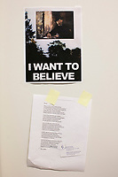 "A poster and a poem hang on a wall in the office of Anthony Amore, the Directory of Security and Chief Investigator at the Isabella Stewart Gardner Museum in Boston, Mass., USA, seen here on Tues., Dec. 5, 2017. The poster on top, reminiscent of Fox Mulder's ""I Want to Believe"" poster in the X-Files, features a reproduction of Manet's ""Chez Tortoni"" in place of the UFO. The poem is a piece written by John Updike about the Gardner Museum theft.  Part of Amore's ongoing work is the investigation into the 1990 theft of 13 pieces from the museum: 10 paintings, 2 objects, and 1 etching. Among the paintings stolen were works by Rembrandt, Vermeer, Degas, and Manet. ""Chez Tortoni"" is one of the paintings that was stolen in the heist."