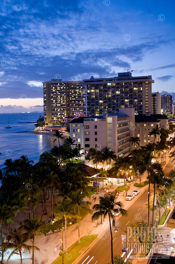 Evening along Kalakaua Avenue and Waikiki Beach