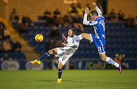 Michael Harriman of Wycombe Wanderers clears from Ben Dickenson of Colchester United during the Sky Bet League 2 match between Colchester United and Wycombe Wanderers at the Weston Homes Community Stadium, Colchester, England on 21 February 2017. Photo by Andy Rowland / PRiME Media Images.