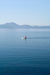 Woman kayaking in the Mediterranean Sea near the Bay of Bodrum