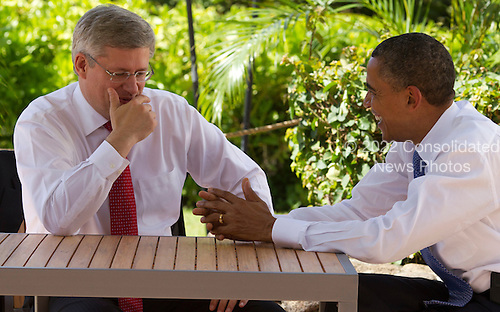 United States President Barack Obama talks with Prime Minister Stephen Harper of Canada during the Asia-Pacific Economic Cooperation (APEC) summit at the J.W. Marriott Hotel in Honolulu, Hawaii on Sunday, November 13, 2011..Credit: Kent Nishimura / Pool via CNP