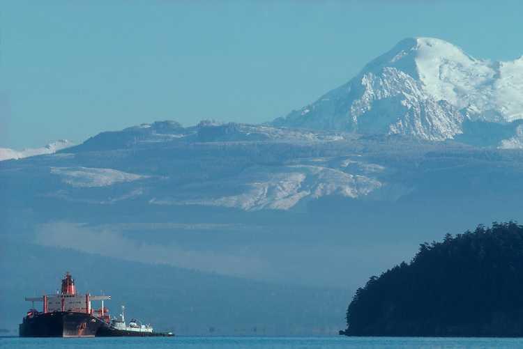 Oil tanker in Puget Sound, Padilla Bay, Guemes Channel,.Anacortes, Washington State, Mount Baker in the distance.