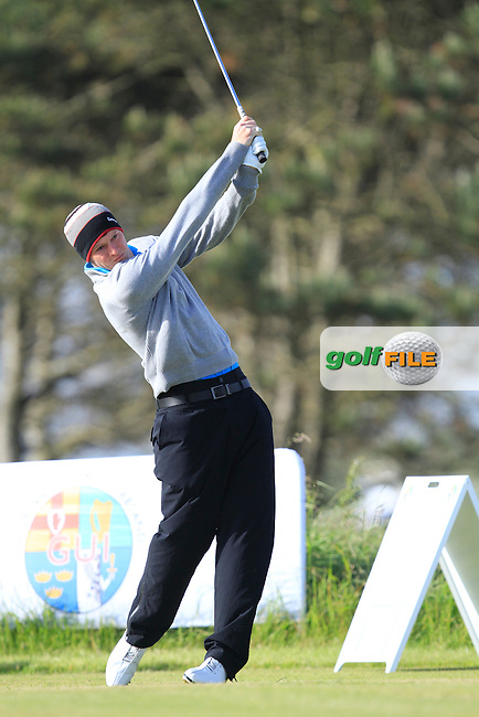 Liam Harnett (Milltown) on the 1st tee during Round 2 of the Irish Amateur Close Championship at Seapoint Golf Club on Sunday 8th June 2014.<br /> Picture:  Thos Caffrey / www.golffile.ie