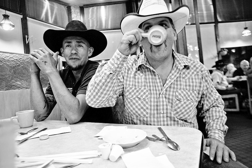 Traveling partners and rodeo cowboys Jimmy Borunda and Jeff Miller at a late night diner on their way home in San Antonio, Texas.  June 29, 2008.