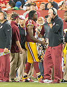 Washington Redskins quarterback Robert Griffin III (10) arrives on the sideline after being injured in the second quarter against the Detroit Lions at FedEx Field in Landover, Maryland on Thursday, August 20, 2015.<br /> Credit: Ron Sachs / CNP
