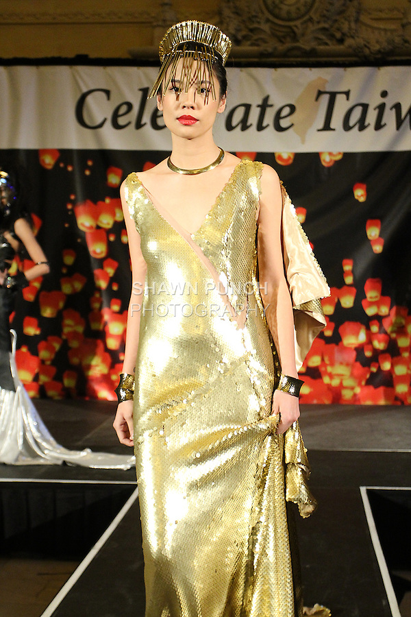 Melody Young walks runway in an outfit from the Alexander King Chen Spring 2015 collection, during the Celebrate Taiwan event in Grand Central Terminal on September 27, 2014.