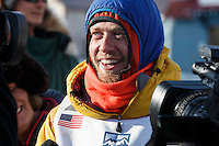 Alan Stevens interviewed at the finish line in Nome on Saturday March 21, 2015 during Iditarod 2015.  <br /> <br /> (C) Jeff Schultz/SchultzPhoto.com - ALL RIGHTS RESERVED<br />  DUPLICATION  PROHIBITED  WITHOUT  PERMISSION