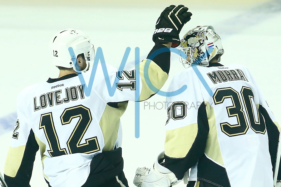 Ben Lovejoy #12 consoles Matt Murray #30 of the Pittsburgh Penguins following their overtime loss to the San Jose Sharks during game three of the Stanley Cup Final at the SAP Center in San Jose, California on June 4, 2016. (Photo by Jared Wickerham / DKPS)