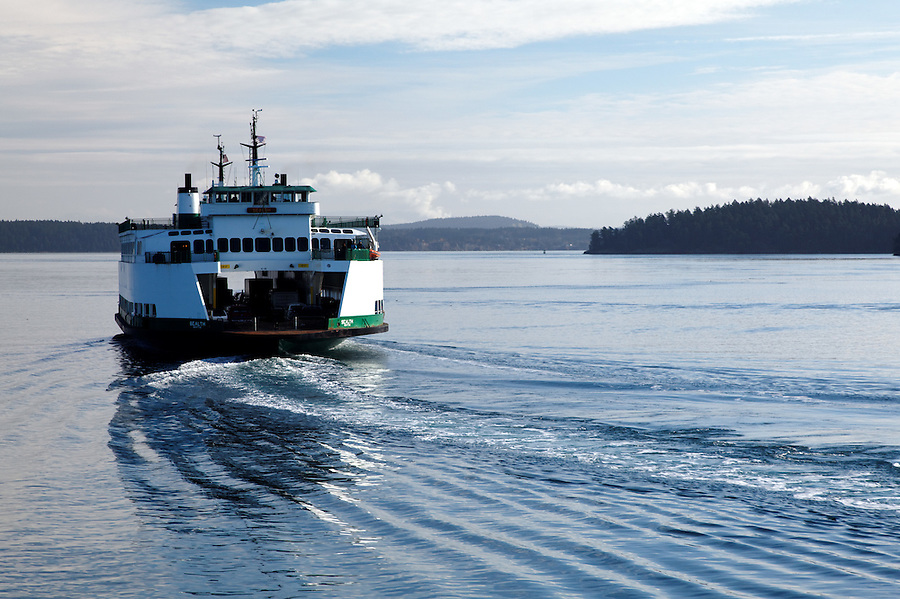 The Washington State Ferry, MV Sealth, cruising through the San San Juan Islands on a calm day, San Juan County, Washington State, USA