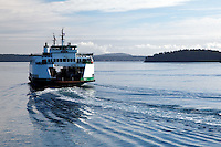 The Washington State Ferry, MV Sealth, cruising through the San San Juan Islands on a calm day, San Juan County, Washington State, USA