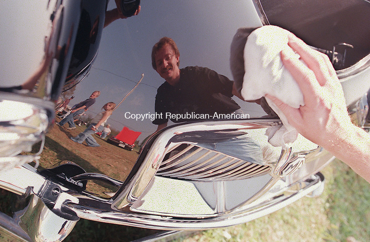 BETHLEHEM,CT-9/27/98-0927CK02.tif-David McFadden of Charlton, Mass polishes off the hood of his MGA 1600 MKII duriong the British MADDness British car show at the Bethlehem fair grounds sponsored by MADD and the Nutmeg MGA on Sunday.    CASEY KEIL PHOTO.