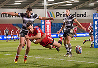 Picture by Allan McKenzie/SWpix.com - 16/03/2018 - Rugby League - Betfred Super League - Salford Red Devils v Hull FC - AJ Bell Stadium, Salford, England - Salford's Jack Littlejohn attempts to keep the ball in play as Hull FC's Jake Connor moves in.