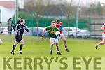 Kerry Captain Peter Crowley breaks away from Peter kelleher Cork during the McGrath cup clash in Mallow on Sunday