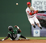 Shortstop Jose Garcia (36) of the Greenville Drive, Class A affiliate of the Boston Red Sox, turns the first half of a double play putting out Carlos Wiloughby (45) of the Augusta GreenJackets on April 7, 2011, at Fluor Field at the West End in Greenville, S.C. Photo by Tom Priddy / Four Seam Images