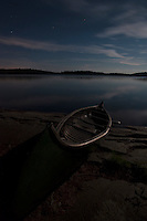 A classic Old Town canoe by moonlight on the shores of David Lake in Killarney Provincial Park, Ontario, Canada.