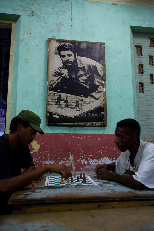 "chess players under a wallpost of ""El Che"" in Santiago de Cuba."