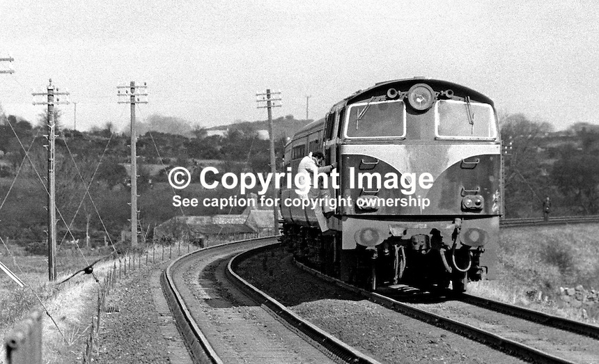 Man climbs aboard the hijacked train which was abandoned by the Provisional IRA near Newry, just north of the Border. No explosives were found. 197403160161<br /> <br /> Copyright Image from Victor Patterson, 54 Dorchester Park, Belfast, UK, BT9 6RJ<br /> <br /> t: +44 28 90661296<br /> m: +44 7802 353836<br /> vm: +44 20 88167153<br /> e1: victorpatterson@me.com<br /> e2: victorpatterson@gmail.com<br /> <br /> For my Terms and Conditions of Use go to www.victorpatterson.com