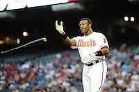 Apr. 26, 2011; Phoenix, AZ, USA; Arizona Diamondbacks outfielder Justin Upton throws his bat after striking out against the Philadelphia Phillies at Chase Field. Mandatory Credit: Mark J. Rebilas-