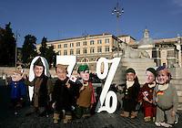 Attivisti della Coalizione Italiana contro la Poverta' (Gcap) indossano maschere raffiguranti i leader del G7, da sinistra, il Presidente del Consiglio Italiano Silvio Berlusconi, il Presidente Francese Nicolas Sarkozy, il Primo Ministro Giapponese Taro Aso, il Primo Ministro Britannico Gordon Brown, il Presidente degli Stati Uniti Barack Obama, il Primo Ministro Canadese Stephen Harper ed il Cancelliere tedesco Angela Merkel, rappresentati come i Sette Nani, durante un'azione dimostrativa in Piazza del Popolo, Roma, 25 novembre 2009, per chiedere il mantenimento della promessa fatta dai sette paesi piu' industrializzati di destinare lo 0,7% del PIL all'aiuto ai paesi in via di sviluppo entro il 2015..Acivists of the Italian Coalition against Poverty (Gcap) wear masks of G7 leaders, from left, Italian Premier Silvio Berlusconi, French President Nicolas Sarkozy,Japanese Prime Minister Taro Aso, British Prime Minister Gordon Brown, US President Barack Obama, Canadian Prime Minister Stephen Harper and German Chancellor Angela Merkel, depicted as the Seven Dwarfs, during a protest in central Rome's Piazza del Popolo square, 25 november 2009, to ask G7 states to keep the promise to spend the 0,7% of their national growth towards overseas development assistance within 2015..UPDATE IMAGES PRESS/Riccardo De Luca