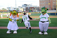 Dayton Dragons mascots greet Beau Amaral #25 on his way to the field before a game against the Bowling Green Hot Rods on April 20, 2013 at Fifth Third Field in Dayton, Ohio.  Dayton defeated Bowling Green 6-3.  (Mike Janes/Four Seam Images)