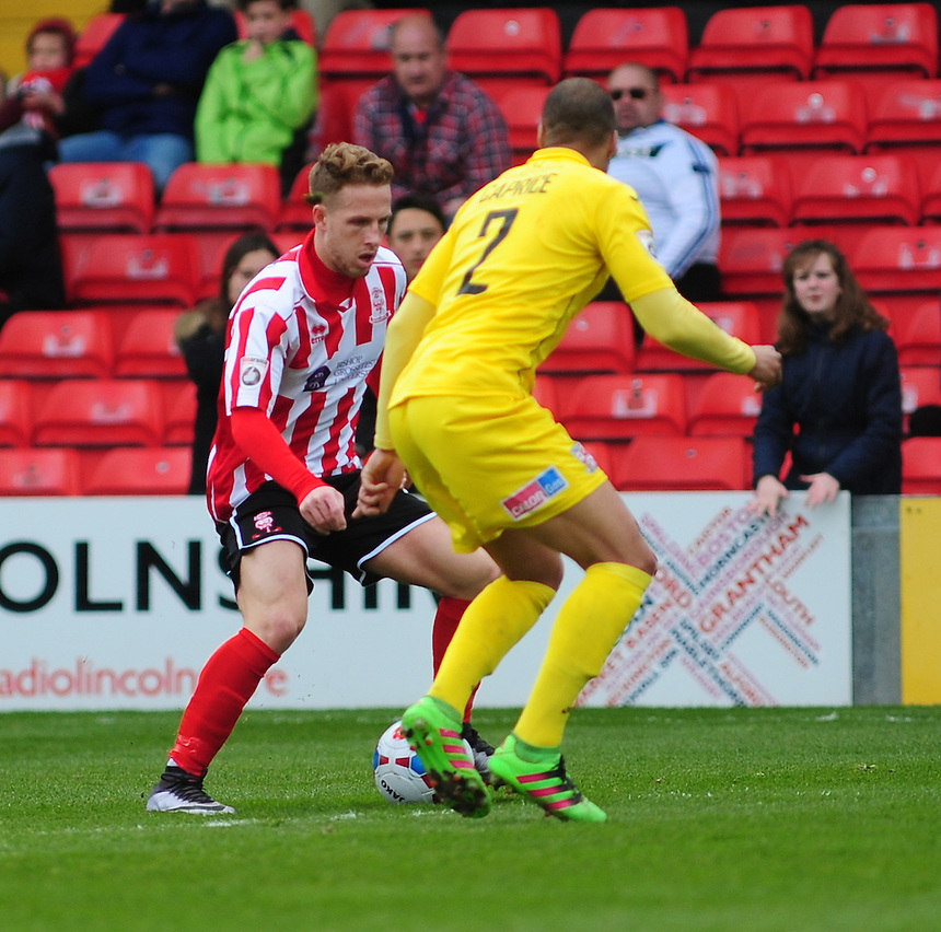 Lincoln City&rsquo;s James Caton vies for possession with Woking's Jake Caprice<br /> <br /> Photographer Andrew Vaughan/CameraSport<br /> <br /> Football - Vanarama National League - Lincoln City v Woking - Saturday 23rd April 2016 - Sincil Bank - Lincoln <br /> <br /> &copy; CameraSport - 43 Linden Ave. Countesthorpe. Leicester. England. LE8 5PG - Tel: +44 (0) 116 277 4147 - admin@camerasport.com - www.camerasport.com