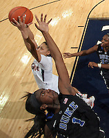 Duke center Elizabeth Williams (1) reaches for the rebound with Virginia guard China Crosby (1) during an NCAA college basketball game in Charlottesville, Va. Duke defeated Virginia 62-41...