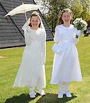 Tara Hageman and Julia Adamiak pictured on their cummunion day.