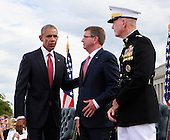 United States President Barack Obama, left, with US Secretary of Defense Ash Carter, center, and US Marine Corps General Joseph F. Dunford Jr., Chairman of the Joint Chiefs of Staff, right, at the Pentagon Memorial in Washington, DC during an observance ceremony to commemorate the 15th anniversary of the 9/11 terrorist attacks, Sunday, September 11, 2016.<br /> Credit: Dennis Brack / Pool via CNP