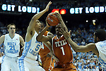 18 December 2013: Texas' Isaiah Taylor (1) is defended by North Carolina's Marcus Paige (5) and Isaiah Hicks (right). The University of North Carolina Tar Heels played the University of Texas Longhorns at the Dean E. Smith Center in Chapel Hill, North Carolina in a 2013-14 NCAA Division I Men's Basketball game. Texas won the game 86-83.