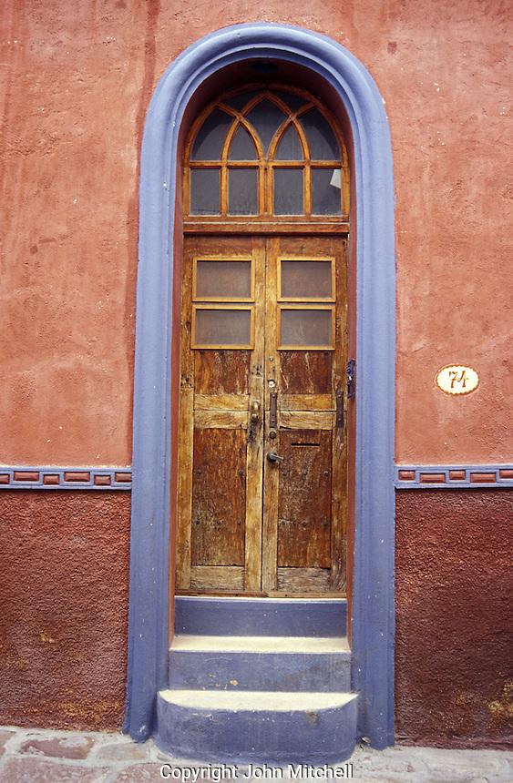 Old door of a restored Spanish colonial house in San Miguel de Allende, Mexico