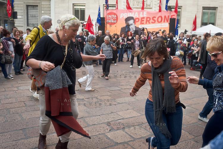 the people dance the Sirtaki music during the presentation of Italy's Tsipras List in Piazza Affari (Milan Stock Exchange) , on April 23, 2014. Photo: Adamo Di Loreto/BuenaVista*Photo