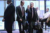 Sean Spicer (r), incoming White House Press Secretary, is seen arriving in the  lobby of the Trump Tower in New York, NY, on January 10, 2017. <br /> Credit: Anthony Behar / Pool via CNP