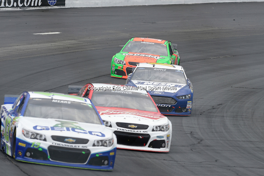 July 13, 2014 - Loudon, New Hampshire, U.S. - Sprint Cup Series driver Danica Patrick (10) brings up the rear heading into a turn at the NASCAR Sprint Cup Series Camping World RV 301 race held at the New Hampshire Motor Speedway in Loudon, New Hampshire. Eric Canha/CSM