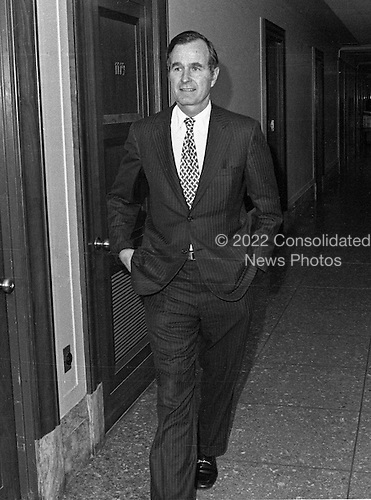 """United States Ambassador to China George H.W. Bush walks through the hall en route to his confirmation hearing to be Director of the U.S. Central Intelligence Agency (CIA) in Washington, D.C. on December 16, 1975..Credit: Benjamin E. """"Gene"""" Forte / CNP"""