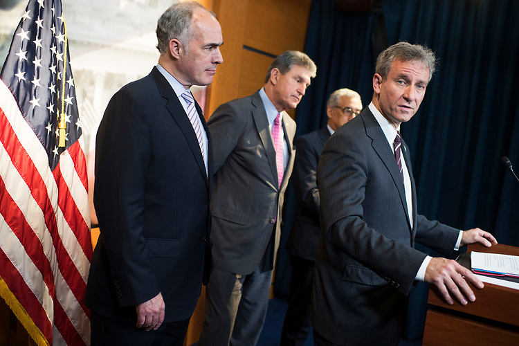 "UNITED STATES - APRIL 5: From left, Sens. Bob Casey, D-Pa., Joe Manchin, D-W.Va., Reps. Bobby Scott, D-Va., and Matt Cartwright, D-Pa., conduct a news conference in the Capitol Visitor Center to introduce miner's health care legislation the ""Black Lung Benefits Improvement Act of 2017"" and the ""Robert C. Byrd Mine Safety Protection Act of 2017,"" April 5, 2017. (Photo By Tom Williams/CQ Roll Call)"
