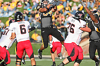 Tigers middle linebacker Brock Christopher (34) leaps to deflect a Texas Tech quarterback Graham Harrell (6) pass during the second half at Memorial Stadium in Columbia, Missouri on October 20, 2007. The Tigers won 41-10.