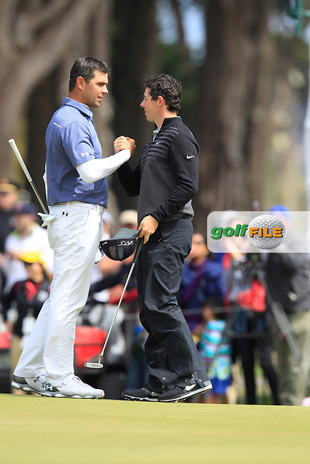 Gary WOODLAND (USA) shakes hands with Rory McIlroy (NIR) during the final round of the WGC Cadillac Matchplay championship, TPC Harding Park, 99 Harding Road, San Francisco, CA 94132, United States. 03/05/2015<br /> Picture Fran Caffrey, www.golffile.ie