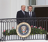 United States President Donald J. Trump and President Emmanuel Macron of France appear on The Truman Balcony during a state visit to The White House in Washington, DC, April 24, 2018. Credit: Chris Kleponis / Pool via CNP