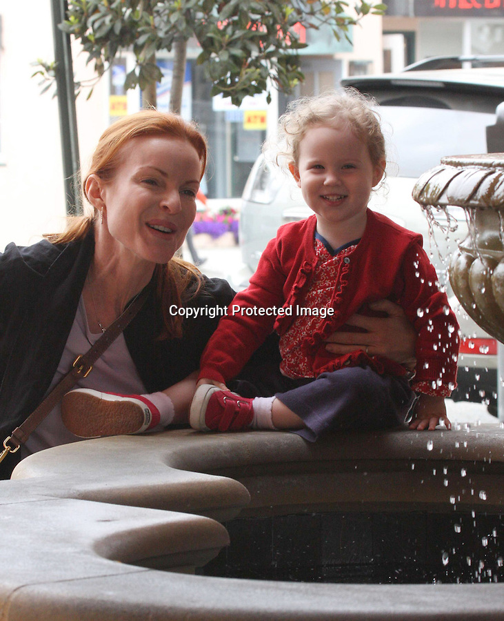 .AbilityFilms@yahoo.com.805-427-3519.www.AbilityFilms.com... .5-11-09.Marcia Cross stopped at a water fountain with her daughter Eden and Savannah & gave her a quarter to make a wish and throw into the fountain Santa monica ca . .