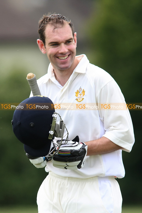 Chris Collier of Gidea Park smiles as he walks off the pitch having been dismissed-Gidea Park CC v Belhus CC - Essex Cricket League - 28/07/12 - MANDATORY CREDIT: George Phillipou/TGSPHOTO - Self billing applies where appropriate - 0845 094 6026 - contact@tgsphoto.co.uk - NO UNPAID USE.