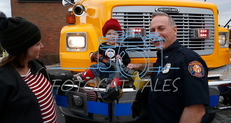 Marshall Jacks, 2, checks out a fire engine as first responders from around the area wait on diners at Bodines and SlotWorld as part of the Feast with a Hero fundraiser in Carson City, Nev., on Saturday, Dec. 15, 2018. <br /> Photo by Cathleen Allison/Nevada Momentum