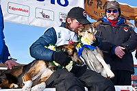 Lance Mackey gives his lead dogs Rev (L) and Maple (R) kisses after winning his 4th consecutive Iditarod in Nome, Alaska