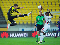 Roly Bonevacia handballs off Alex Rufer (left) during the A-League football match between Wellington Phoenix and Western Sydney Wanderers at Westpac Stadium in Wellington, New Zealand on Saturday, 3 November 2018. Photo: Dave Lintott / lintottphoto.co.nz