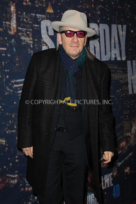 WWW.ACEPIXS.COM<br /> February 15, 2015 New York City<br /> <br /> Elvis Costello walking the red carpet at the SNL 40th Anniversary Special at 30 Rockefeller Plaza on February 15, 2015 in New York City.<br /> <br /> Please byline: Kristin Callahan/AcePictures<br /> <br /> ACEPIXS.COM<br /> <br /> Tel: (646) 769 0430<br /> e-mail: info@acepixs.com<br /> web: http://www.acepixs.com