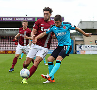 Fleetwood Town's Bobby Grant competing with Northampton Town's Joe Iaciofano <br /> <br /> Photographer Andrew Kearns/CameraSport<br /> <br /> The EFL Sky Bet League One - Northampton Town v Fleetwood Town - Saturday August 12th 2017 - Sixfields Stadium - Northampton<br /> <br /> World Copyright &copy; 2017 CameraSport. All rights reserved. 43 Linden Ave. Countesthorpe. Leicester. England. LE8 5PG - Tel: +44 (0) 116 277 4147 - admin@camerasport.com - www.camerasport.com