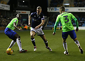 9th February 2018, The Den, London, England; EFL Championship football, Millwall versus Cardiff City; Lee Gregory of Millwall runs past Sol Bamba and Joe Bennett of Cardiff City