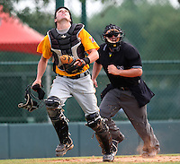 GCL Pirates catcher Dylan Child #30 looks for a foul pop up in front of umpire Jorge Teran during a game against the GCL Braves at Disney Wide World of Sports on June 25, 2011 in Kissimmee, Florida.  The Pirates defeated the Braves 5-4 in ten innings.  (Mike Janes/Four Seam Images)