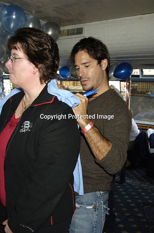 Ricky Paull Goldin and fan ..at the Ricky Paull Goldin Cruise for his fans onboard The World Yacht Temptress boat on October 15, 2005 benefitting Hurricane Katrina victims. ..Photo by Robin Platzer, Twin Images..